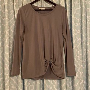 Gray long sleeved top.